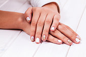 Beautiful manicure of gel varnish. Golden White