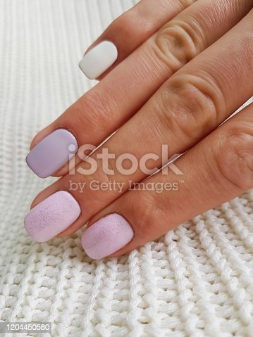 1147741037 istock photo Beautiful manicure on female hand 1204450580