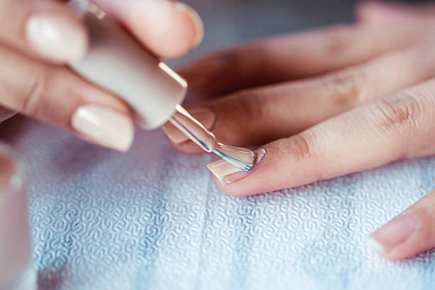 Beautiful manicured woman's nails with cream nail stock photo
