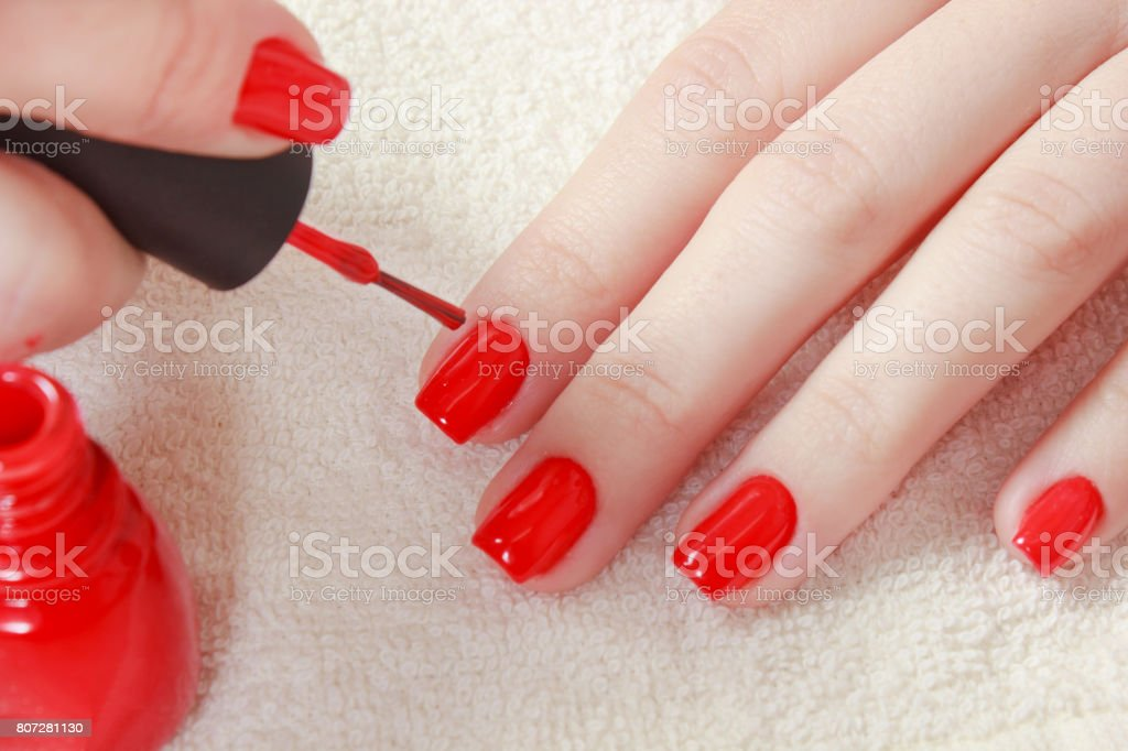 Manicure - Beautiful manicured woman\'s nails with red nail polish on...