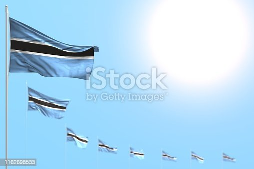 istock beautiful many Botswana flags placed diagonally with bokeh and free space for text - any occasion flag 3d illustration 1162698533