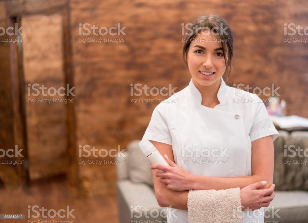 Beautiful masseuse working at a spa stock photo