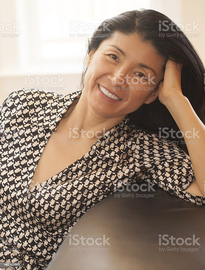 beautiful mature asian woman smiling stock photo & more pictures of