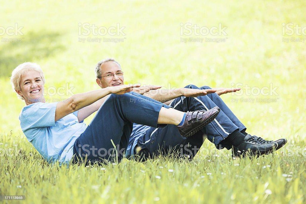 Beautiful mature couple exercising royalty-free stock photo