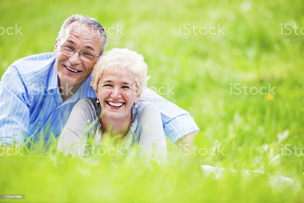 Beautiful mature couple lying in nature. royalty-free stock photo