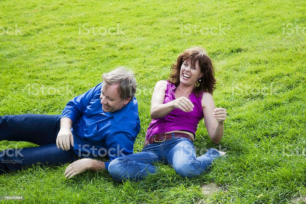 Beautiful Mature Couple Outside Playing and Laughing royalty-free stock photo