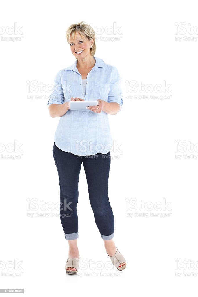 Beautiful mature lady with a tablet computer stock photo