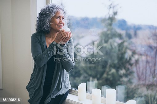istock A beautiful mature ethnic woman drinks tea in the morning 884298216