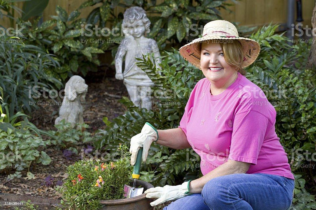 Beautiful mature woman gardening. royalty-free stock photo