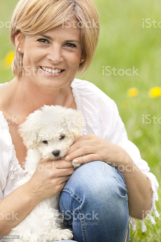 beautiful mature woman holding little maltese terrier royalty-free stock photo