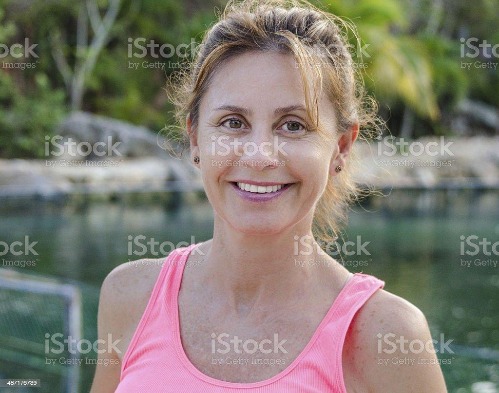 Beautiful mature woman in pink tank top stock photo