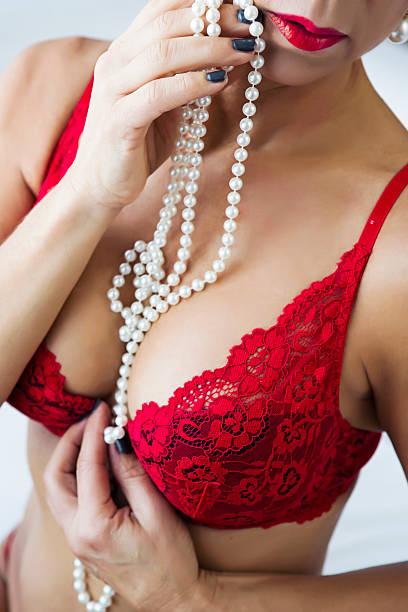 美しいマチュア woman in red lingerie ストックフォト