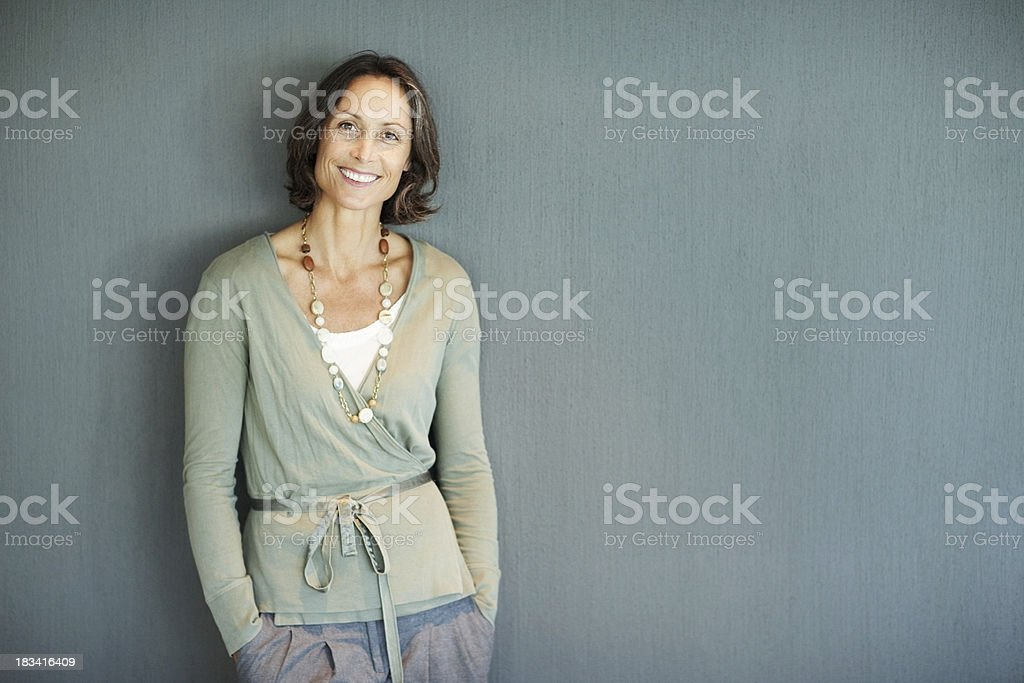 Beautiful mature woman in stylish outfit with lots of copyspace stock photo