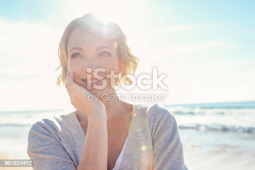 istock Beautiful mature woman portrait on the beach. 961624412