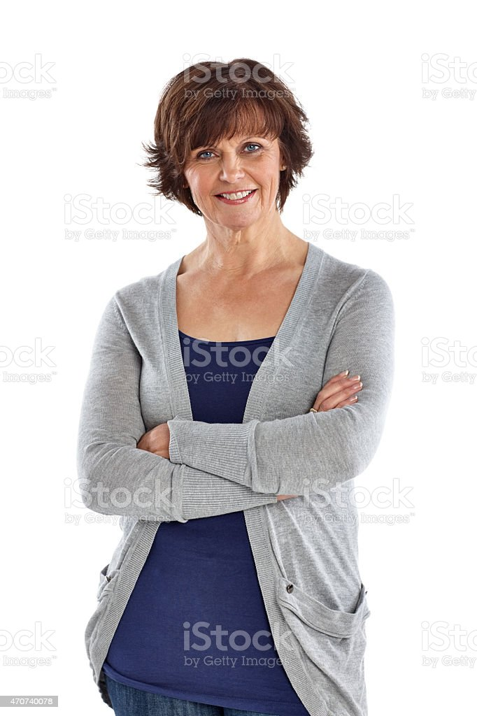 Beautiful mature woman standing with her arms crossed stock photo