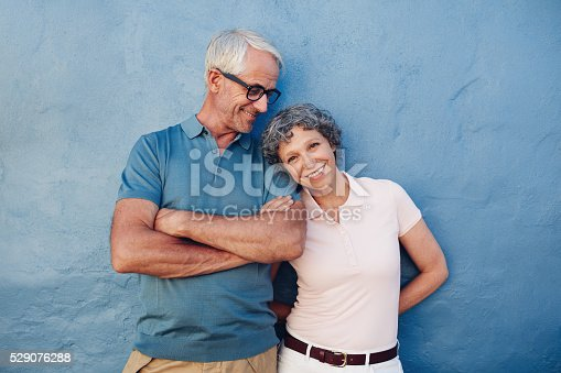 istock Beautiful mature woman standing with her husband 529076288