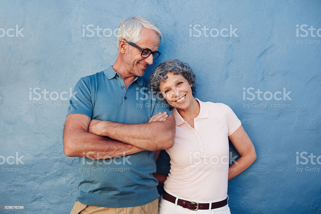 Beautiful mature woman standing with her husband stock photo