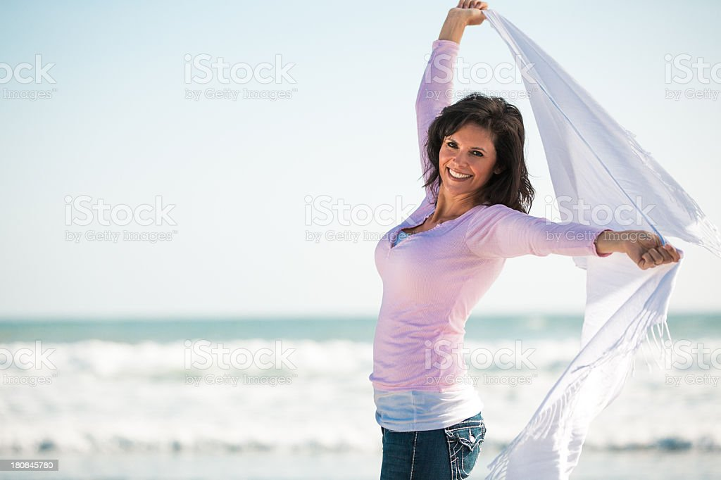 Beautiful mature woman with arms raised royalty-free stock photo
