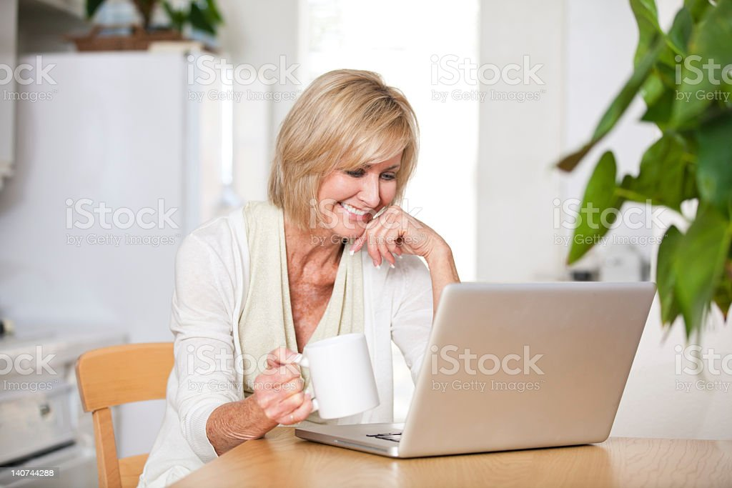 Beautiful, mature woman with computer royalty-free stock photo