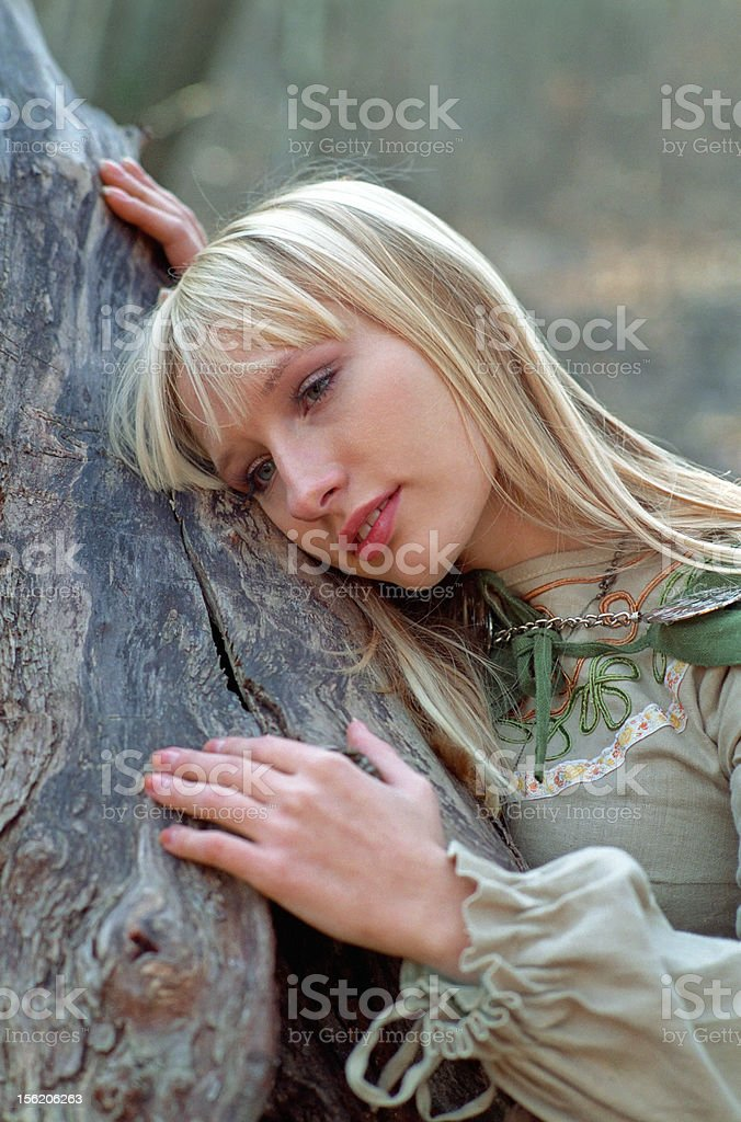 beautiful medieval woman lying on trunk royalty-free stock photo