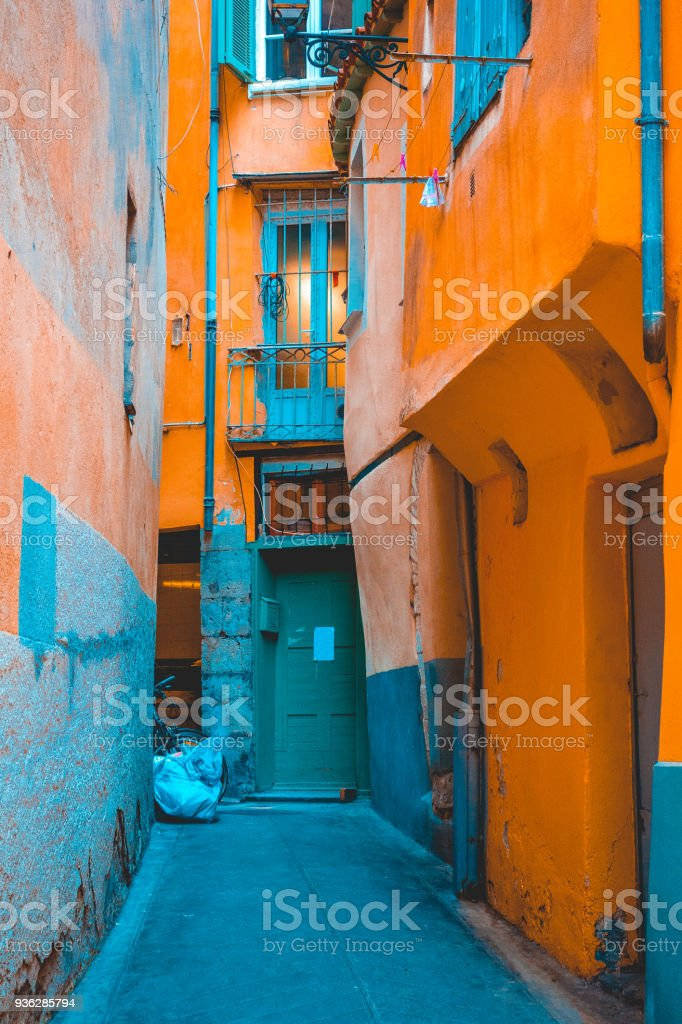 beautiful mediterranean alley in orange and blue colors stock photo