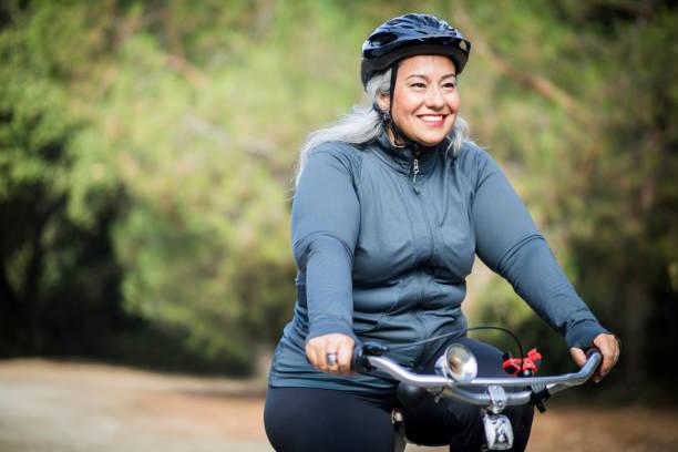 Beautiful Mexican Woman Biking stock photo