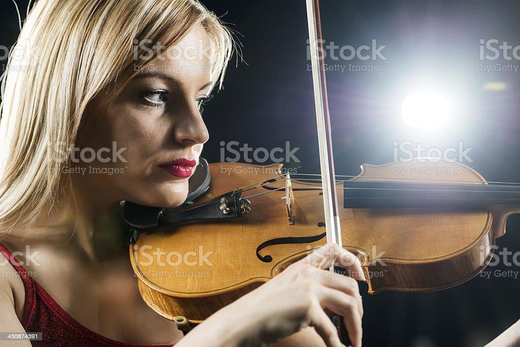 Beautiful mid adult violinist. stock photo