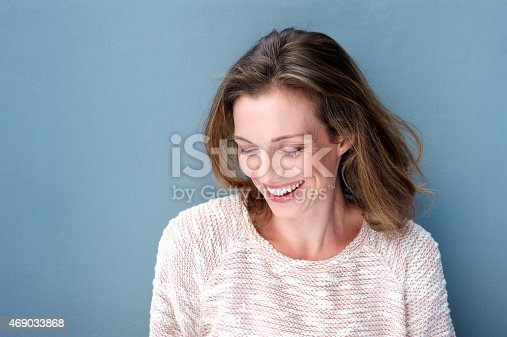 istock Beautiful mid adult woman laughing with sweater 469033868