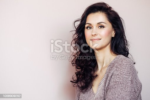 istock Beautiful mid adult woman 1058909252