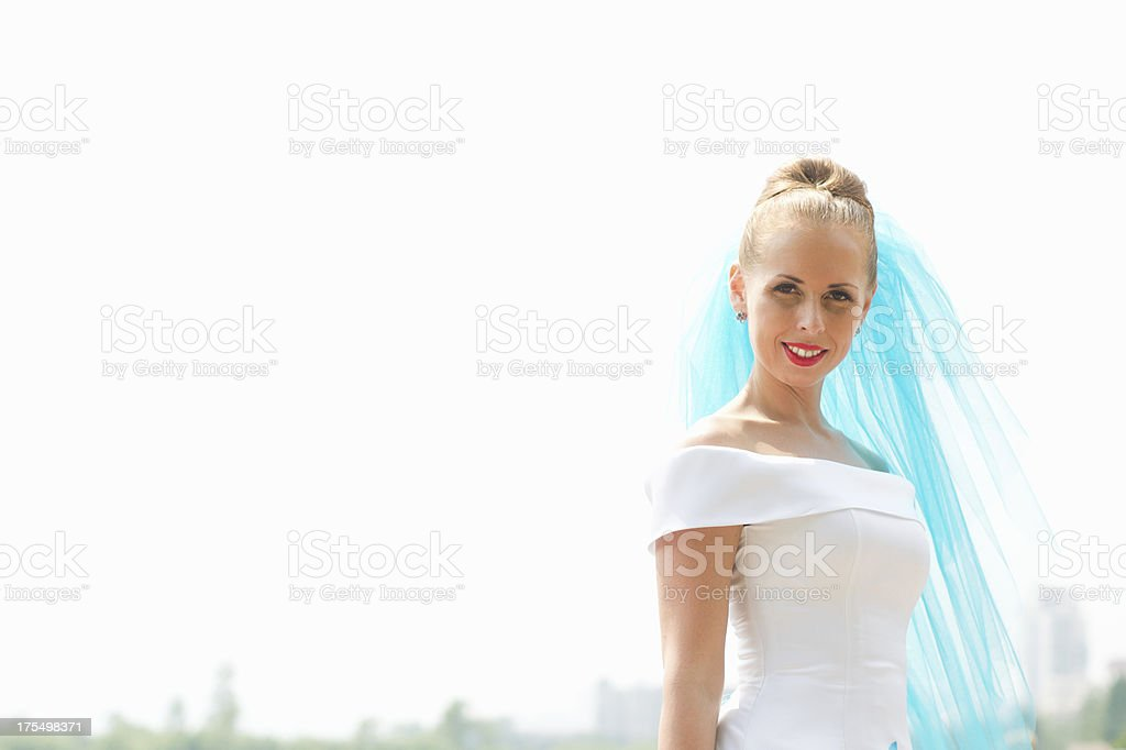 Beautiful mid aged bride against the sky royalty-free stock photo