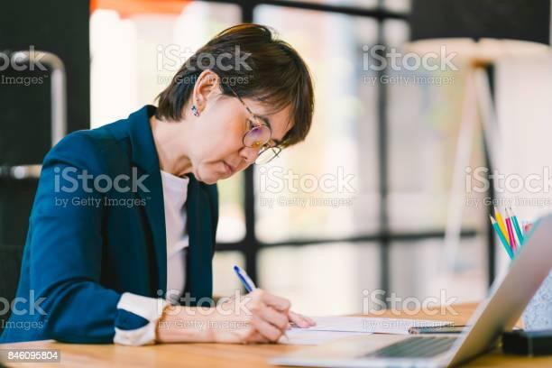 Beautiful middle age asian woman working on paperwork in modern picture id846095804?b=1&k=6&m=846095804&s=612x612&h=0 ywd0taxpj6qn4m1 12qxb8qxuj4wgwweotariust4=