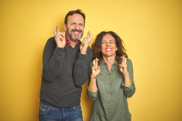 Beautiful middle age couple over isolated yellow background gesturing picture id1174149735?b=1&k=6&m=1174149735&s=612x612&w=0&h=llahd50nhxfvqhl i0fa nshgau3pveskjb0pptc8ww=