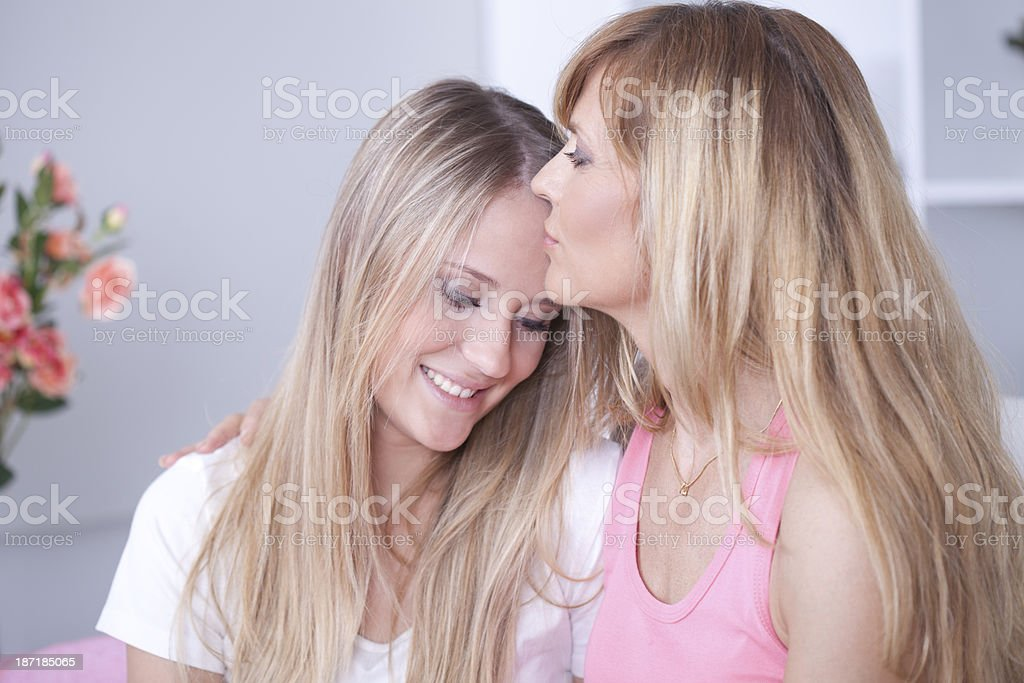 Girl kissing old lady Category:Females kissing