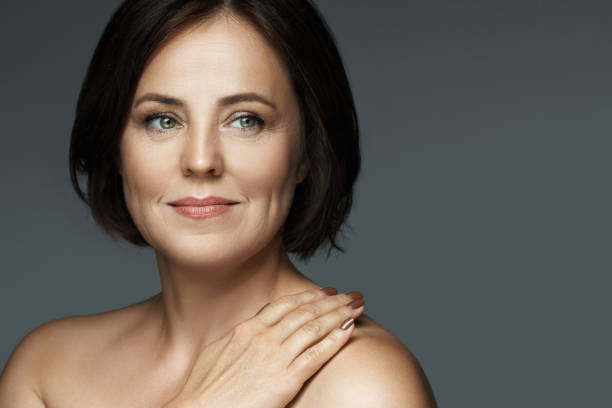 Beautiful middle aged woman with clean wrinkled skin stock photo