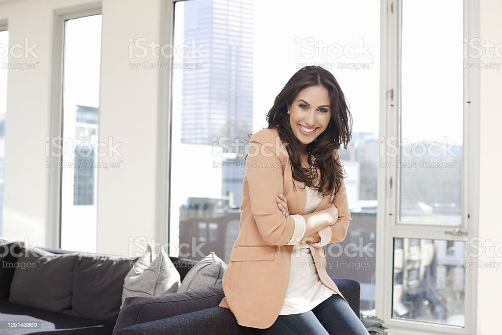 Beautiful Middle Eastern Woman Portrait in Loft with Book, Copyspace stock photo