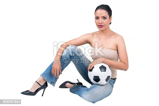 istock Beautiful middle-aged Asian woman holding Soccer ball  isolated on white background 928267634