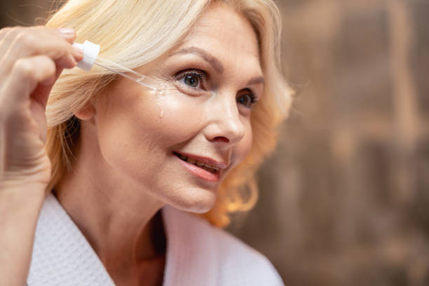 Beautiful middle-aged woman making a cosmetic procedure stock photo