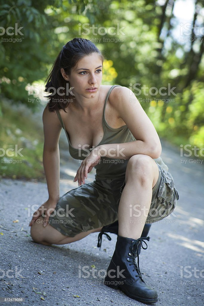Beautiful military woman training in park stock photo