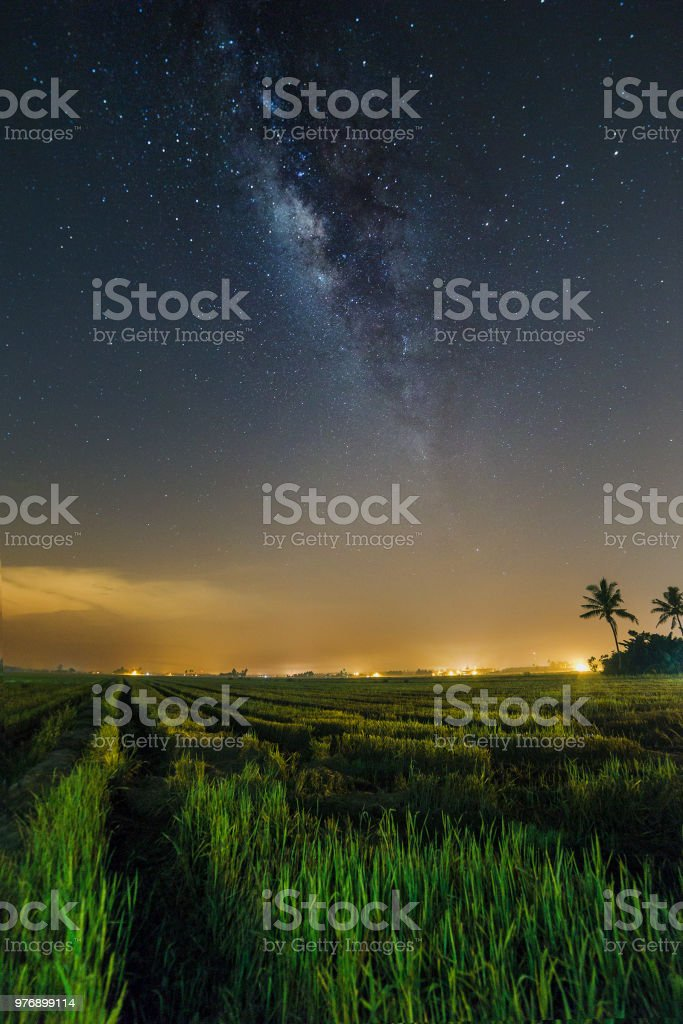 Beautiful milkyway in the middle of night at Sekinchan, Selangor, Malaysia ( Visible noise due to high ISO, soft focus, shallow DOF, slight motion blur) stock photo