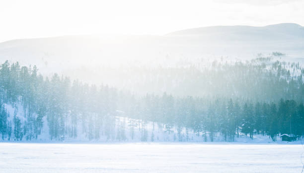 A beautiful minimalist landscape of a frozen lake in central Norway. stock photo