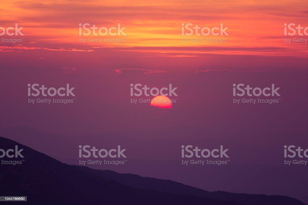 A Beautiful Minimalist Scenery Of Mountain Sunset In Purple