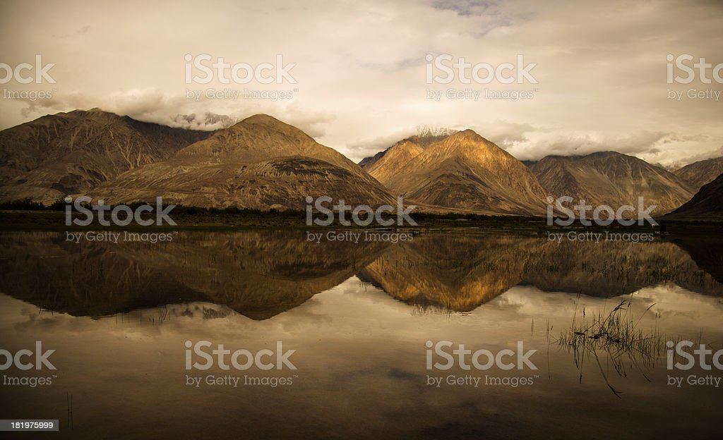 Beautiful mirror mountain with grass land royalty-free stock photo
