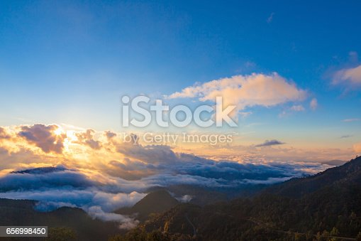Beautiful Misty Morning Sunrise with clear blue sky in morning at Doi Ang khang Chiang Mai Thailand.