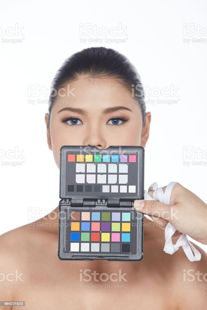 Beautiful Mix Race Woman with Color Checker stock photo