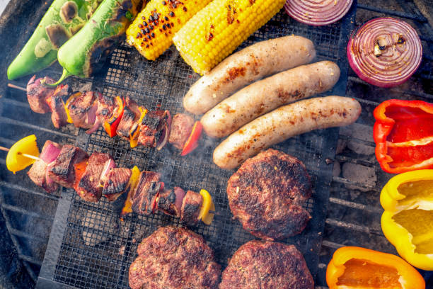 A Beautiful Mixed Grill Meat And Fresh Vegetables Arranged On A Charcoal Grill stock photo