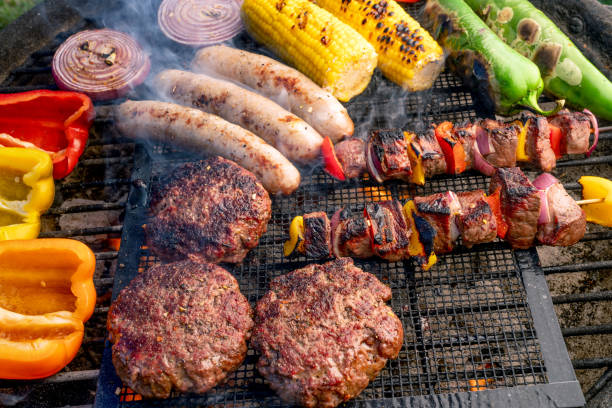 A Beautiful Mixed Grill, Meat And Fresh Vegetables Arranged On A Charcoal Grill stock photo