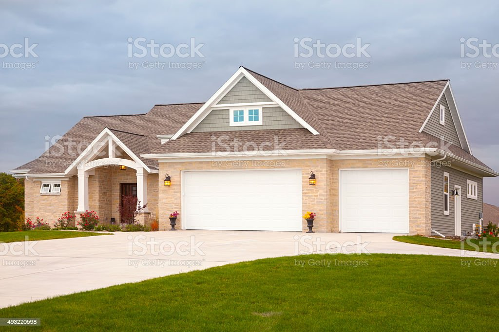 Beautiful Mixed Materials Ranch Style Home, Early Evening stock photo