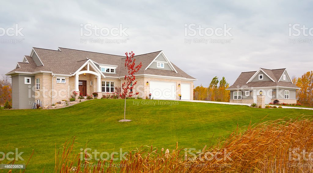 Beautiful Mixed Materials Ranch Style Home With Guest House stock photo