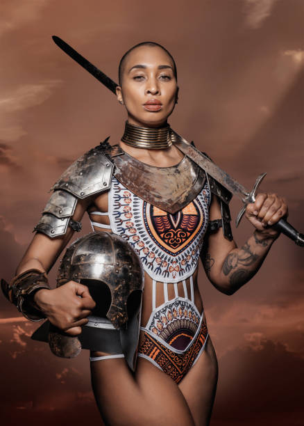 beautiful mixed race sword wielding viking warrior female - indumento corazzato foto e immagini stock