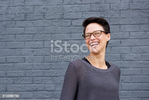 510397772 istock photo Beautiful mixed race woman laughing with glasses 510399734